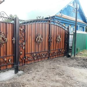 Изготовление металлических ворот,  решеток,  навесов,  заборов,  дверей и